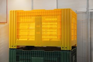 Stacked Yellow Plastic Pallet Container Crate Box